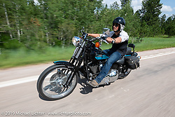 17-year old twin Luke Knight riding a 1996 Harley-Davidson Bad Boy on the Cycle Source ride down Vanocker Canyon back from Nemo to the Iron Horst Saloon during the Sturgis Black Hills Motorcycle Rally. SD, USA. Wednesday, August 7, 2019. Photography ©2019 Michael Lichter.