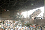 Domestic waste treatment centre. The waste dumped here after collection is sorted and processed using a specially designed mechanical biological treatment process. This process was designed by Israeli sanitation engineers, and this waste transfer station, in Hiriya, Israel, is the largest in the Middle East. It is operated by the local municipality, the Dan Association of Towns.