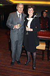 Football correspondent JIMMY HILL and his wife BRYONY at a party to celebrate the opening of The Sportsman - a casino, bar and restaurant in Old Quebec Street, London W1 on 12th January 2005.  Proceeds from the casino were donated to the charity Sparks the sports charity.<br /><br />NON EXCLUSIVE - WORLD RIGHTS