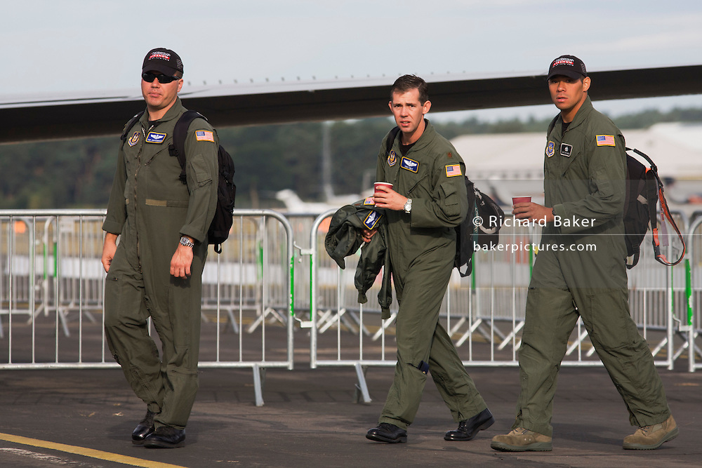 US Air Force pilots arrive for another day presenting their aircraft to the public at the Farnborough Airshow.