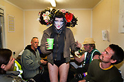 Glastonbury Festival, 2015. Shangri La is a festival of contemporary performing arts held each year within Glastonbury Festival. The theme for the 2015 Shangri La was Protest. <br /> Performer with the crew backstage on the Hell stage.