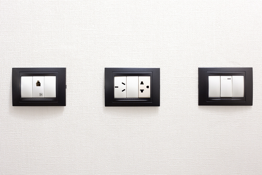 Electrical outlets on a white wall