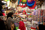 The traditional market in Yogyakarta, Indonesia is very busy selling all sorts of batik, fabrics, and other clothing items.