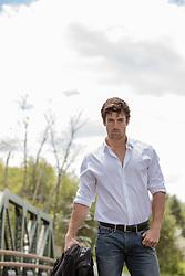rugged man in a white button down shirt