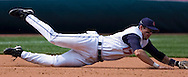 MORNING JOURNAL/DAVID RICHARD<br />Cleveland third baseman Aaron Boone dives during yesterday's win over Kansas City.