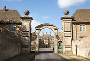 Stone archway entrance to Corsham Court, Wiltshire, England, UK