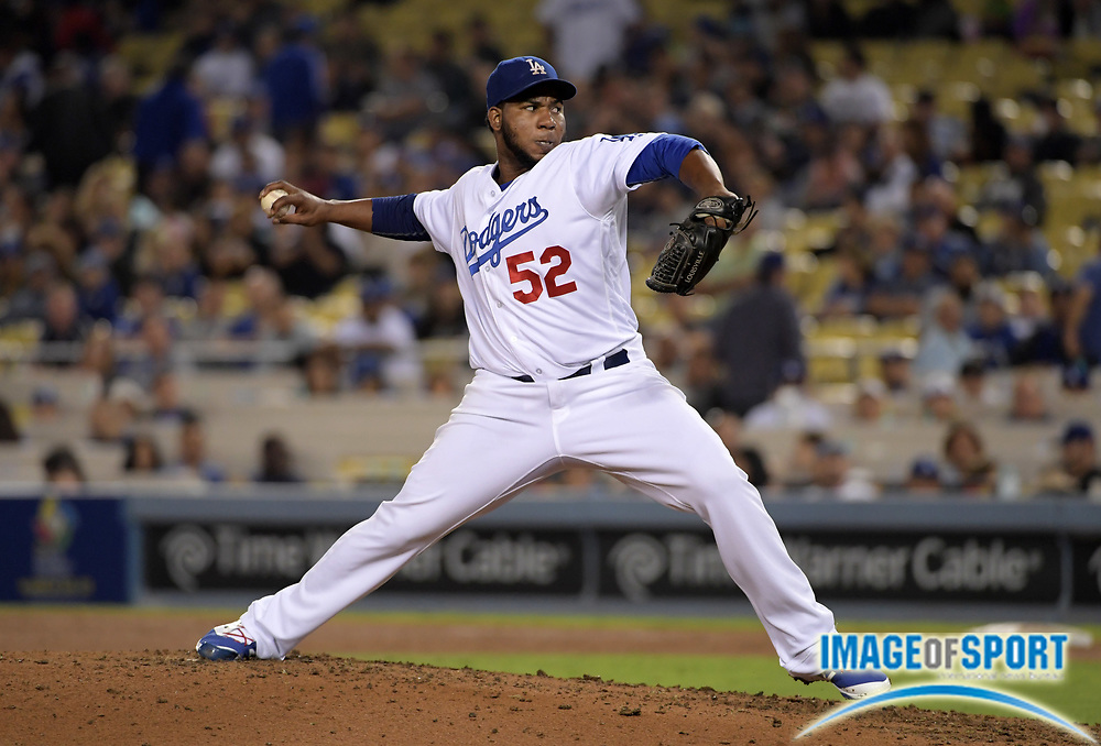 Sep 6, 2016; Los Angeles, CA, USA; Los Angeles Dodgers relief pitcher Pedro Baez (52) delivers a pitch against the Arizona Diamondbacks during a MLB game at Dodger Stadium.