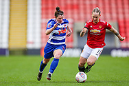 Reading defender Emma Mitchel (3) and Manchester United midfielder Leah Galton (11) chase the ball during the FA Women's Super League match between Manchester United Women and Reading LFC at Leigh Sports Village, Leigh, United Kingdom on 7 February 2021.