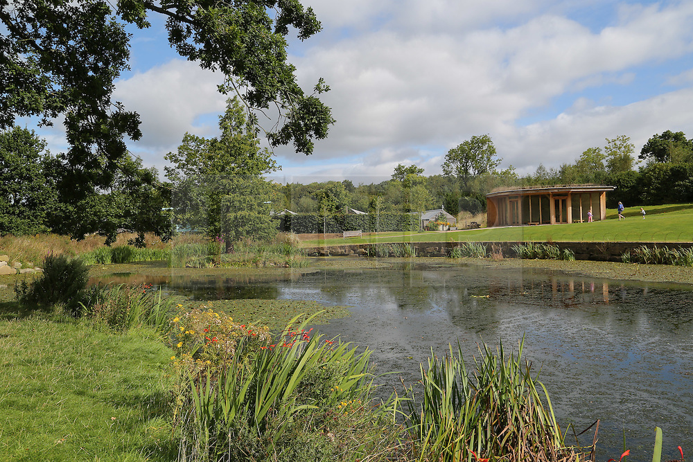 © Licensed to London News Pictures. 01/09/2016. Harrogate, UK. The sun hits Queen Mother's Lake as summer comes to an end at RHS Garden Harlow Carr in Harrogate, North Yorkshire. Today marks the first day of autumn and the end of summer. Photo credit : Ian Hinchliffe/LNP