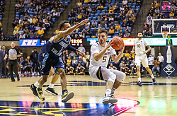 Dec 1, 2019; Morgantown, WV, USA; West Virginia Mountaineers guard Jordan McCabe (5) fakes a pass during the second half against the Rhode Island Rams at WVU Coliseum. Mandatory Credit: Ben Queen-USA TODAY Sports