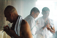India, Gokarna, 2006. Hindu men have been washed and shaven clean in preparation for purification by smoke.