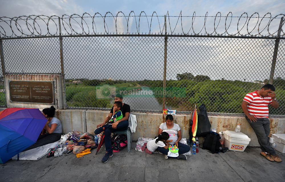 July 4, 2018 - Matamoros, Mexico - July 4, 2018 Ð Matamoros, Mexico - Diana Zumiga, 31 and 8-months pregnant sleeps on bridge with her daughter Daylin Zuniga, 3 years old. They are from Guatemala.  Her father Hentry Zuniga (stripe shirt) brought them here as he said it was unsafe in their homeland, but does not plan to cross. Others on bridge requested not to be identified. Asylum seekers sleep on B/M International Bridge, Matamoros-Brownsville, waiting to cross into U.S. from Mexico side. If not for a small humanitarian group Asociacion Civil Ayudandoles a Triunfar a.c. run by Glady Canas from Mexico they would have not had blankets to sleep on, food, water, etc.  It is unknown whether they have as yet been allowed in to be processed for credible fear. Later that night in the far distance, fireworks went off as America celebrated Independence Day. (Credit Image: © Carol Guzy via ZUMA Wire)