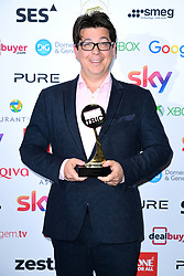 Michael McIntyre with the award for best Entertainment Programme at the TRIC Awards 2019 50th Birthday Celebration held at the Grosvenor House Hotel, London.