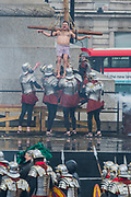 Convicts ar crucified next to Jesus - The Wintershall Players open-air re-enactment of 'The Passion of Jesus' on Good Friday in the rain in Trafalgar Square. It featured a cast of over 100 volunteers from in and around London.