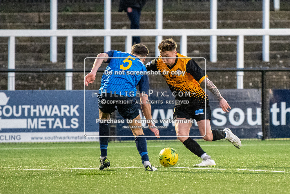 BROMLEY, UK - JANUARY 04: Joel Rollinson, of Cray Wanderers FC, takes on Sean Grace, of Wingate & Finchley,  during the BetVictor Isthmian Premier League match between Cray Wanderers and Wingate & Finchley at Hayes Lane on January 4, 2020 in Bromley, UK. <br /> (Photo: Jon Hilliger)