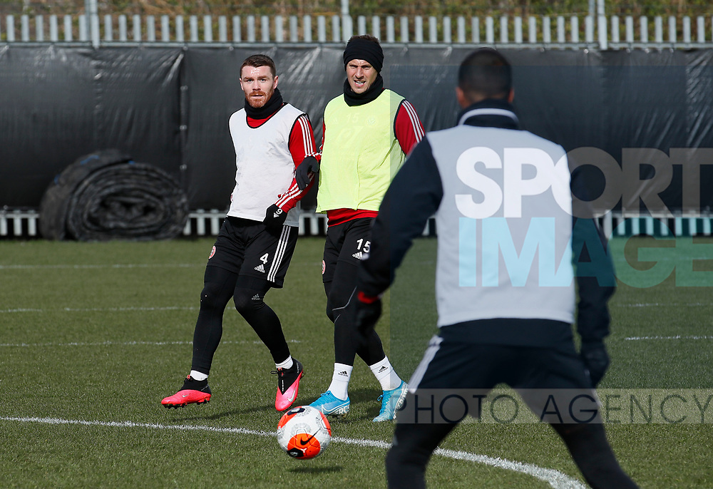 John Fleck of Sheffield Utd and Phil Jagielka of Sheffield Utd during a training session at the Steelphalt Academy, Sheffield. Picture date: 5th March 2020. Picture credit should read: Simon Bellis/Sportimage