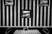J & B's Cafe. Black and white striped wall paper, with old photos, cafe, Harlingen, Texas