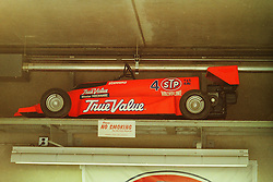 Indianapolis Time Trials, May 1987<br /> STP Go Cart in garage of Roberto Guerrero.<br /> <br /> A scan from an old photo or slide from the collection of Alan and Becky Look dated 1987 and 1988.
