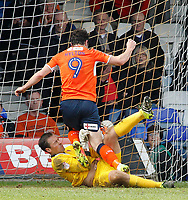 Blackpool's Dean Lyness gets down bravely to prevent Luton Town's Danny Hylton from scoring<br /> <br /> Photographer David Shipman/CameraSport<br /> <br /> The EFL Sky Bet League Two - Luton Town v Blackpool - Saturday 1st April 2017 - Kenilworth Road - Luton<br /> <br /> World Copyright © 2017 CameraSport. All rights reserved. 43 Linden Ave. Countesthorpe. Leicester. England. LE8 5PG - Tel: +44 (0) 116 277 4147 - admin@camerasport.com - www.camerasport.com
