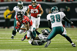 Atlanta Falcons wide receiver Roddy White #84 carries the ball during the NFL game between the Philadelphia Eagles and the Atlanta Falcons on December 6th 2009. The Eagles won 34-7 at The Georgia Dome in Atlanta, Georgia. (Photo By Brian Garfinkel)
