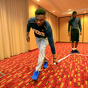 Head managers Deshaun Cole, front, and Brandon Jackson tape markings similar to a basketball court so the team can walk through plays at the hotel prior to the game in Muncie, Ind., on Saturday, February 17, 2018. The arena was unavailable due to another Ball State team needing it, so the team had to make do in the ballroom at the hotel. THE BLADE/KURT STEISS