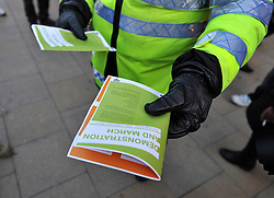 © London News Pictures. 2011/01/19 A policeman hands out leaflets. A rally and march in central London, UK, today (Wed) held by students on the day MPs are to vote on a Labour call for a rethink of the government's decision to scrap the Education Maintenance Allowance for low-income students. Picture credit should read Stephen Simpson/LNP