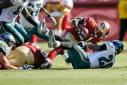 12 Oct 2008: San Francisco 49ers running back Frank Gore #21 is brought down by Philadelphia Eagles FS Brian Dawkins #20 during the game against the Philadelphia Eagles on October 12th, 2008. The Eagles won 40-26 at Candlestick Park in San Francisco, California. (Photo by Brian Garfinkel) (Photo by Brian Garfinkel)