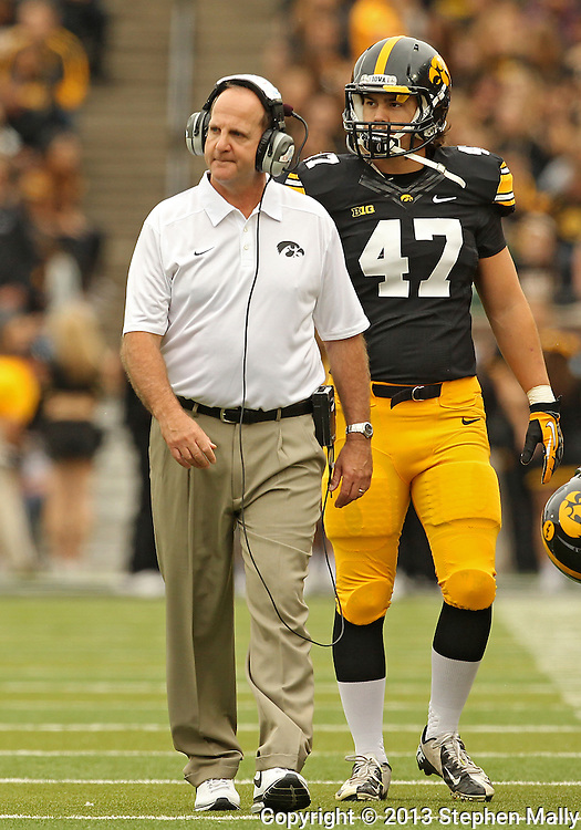 October 6 2013: Iowa Hawkeyes Defensive Coordinator Phil Parker walks with Iowa Hawkeyes linebacker John Kenny (47) during the first quarter of the NCAA football game between the Michigan State Spartans and the Iowa Hawkeyes at Kinnick Stadium in Iowa City, Iowa on October 6, 2013. Michigan State defeated Iowa 26-14.