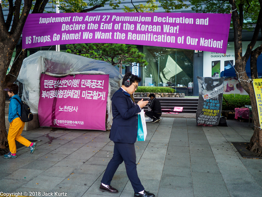 10 OCTOBER 2018 - SEOUL, SOUTH KOREA: A sign hanging near the US Embassy in Seoul calling for the withdrawl of American troops in South Korea and the reunification of the two Koreas.    PHOTO BY JACK KURTZ