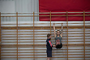 British freestyle skier Rowan Cheshire with gymnastic coach Ross Hill at the Leeds Gymnastic Club on 21st July 2017 in Leeds, United Kingdom. Leeds Gymnastic Club is one of the training facilities for the GB Snow team in the UK.