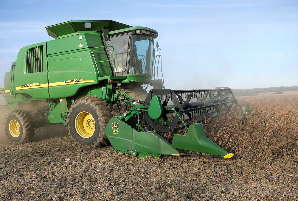 Kevin Brewer rides a combine as he works to harvest soybeans Oct. 25, 2018, on his Brewer family farm in Bangor, Pennsylvania. Recent retaliatory tariffs implemented by China on grain exports, including soybeans which are the top agricultural export in the United States, are hurting farmers in Pennsylvania. (Photo by Matt Smith)