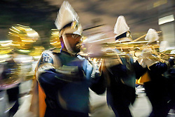 03 February 2016. New Orleans, Louisiana.<br /> Mardi Gras. A marching band flashes by with the all female Mystic Krewe of Nyx as the Krewe parades along Magazine Street.<br /> Photo©; Charlie Varley/varleypix.com