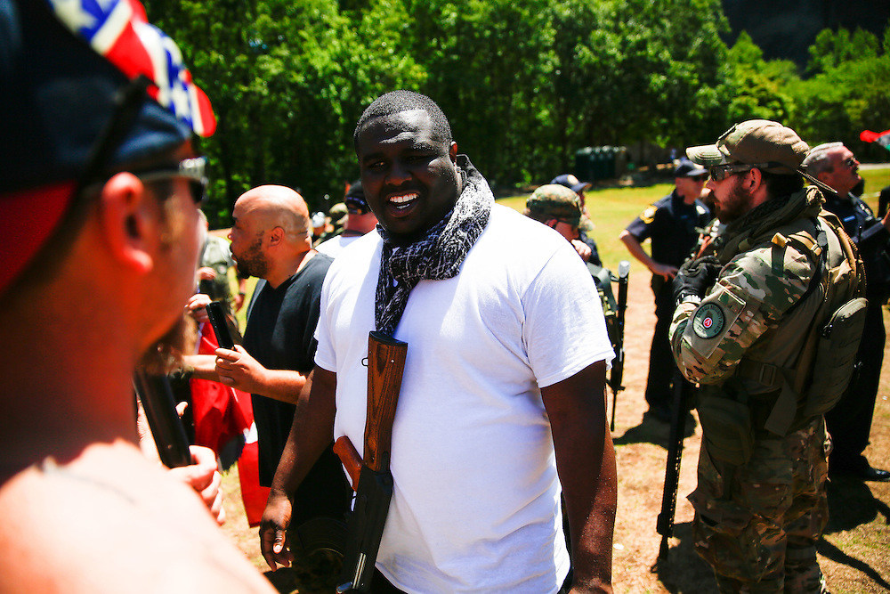 """Photos from """"Rock Stone Mountain"""" white pride rally and anti-protesters at Stone Mountain Park on Saturday, April 23, 2016. Photo by Kevin D. Liles/kevindliles.com"""