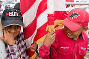 "10 SEPTEMBER 2004 - WINDOW ROCK, AZ: Navajo children wait to enter the arena before the ""Wooly Ride"" at the 58th annual Navajo Nation Fair in Window Rock, AZ. The Navajo Nation Fair is the largest annual event in Window Rock, the capitol of the Navajo Nation, the largest Indian reservation in the US. The Navajo Nation Fair is one of the largest Native American events in the United States and features traditional Navajo events, like fry bread making contests, pow-wows and an all Indian rodeo. The Wooly Ride, also called Mutton Busting, is a rodeo for children six years old and younger. The youngsters are set on a sheep which is then turned loose in the arena. Points are awarded for style and length of ride. Wooly Riding is extremely popular on the Navajo reservation, which has a strong cattle and sheep ranching tradition.  PHOTO BY JACK KURTZ"