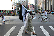 11 September 2010- New York, NY-Muslim Man holds out literature to people at the protests of the construction of the controversial Cordoba House, the Muslim Cultural Center to be constructed by The Park51 Group, demonstrate in lower Manhattan blocks from the World Trade Center. Many  surviving family members of victims of the 9/11 Attacks were in attendance in this hotly debated and contested area in lower Manhattan on September 11, 2010 in New York City. Photo Credit: Terrence Jennings/Sipa Press