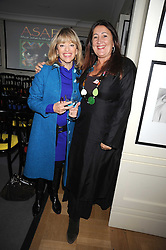 Left to right, EDINA RONAY and LYNNE FRANKS at a tea in aid of ASAP - African Solutions to African Problems, held at Vogue House, Hanover Square, London on 22nd October 2008.