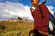 Fusi Matli, 11, a grade 4 student at English Grammar School in Teyateyaneng, Lesotho, eats Coco Berries near his home after school.
