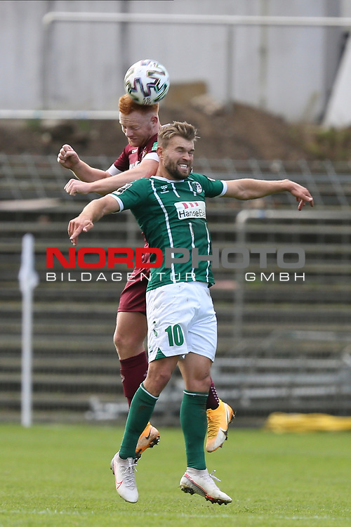 17.10.2020, Dietmar-Scholze-Stadion an der Lohmuehle, Luebeck, GER, 3. Liga, VfB Luebeck vs SG Dynamo Dresden <br /> <br /> im Bild / picture shows <br /> Zweikampf/Kopfball. Kopfballduell zwischen Paul Will (SG Dynamo Dresden) und Yannick Deichmann (VfB Luebeck) <br /> <br /> DFB REGULATIONS PROHIBIT ANY USE OF PHOTOGRAPHS AS IMAGE SEQUENCES AND/OR QUASI-VIDEO.<br /> <br /> Foto © nordphoto / Tauchnitz
