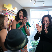 COLUMBIA SC - FEBRUARY 16: California Senator Kamala Harris speaks to Hartley Mai Hamre and Tyce Hamre at supporters at a scheduled campaign stop at Styled By NAIDA, a upscaled used clothing store, to meet potential 2020 presidential primary voters in Columbia, SC on February 16, 2019. (Logan Cyrus for The Los Angeles Times)