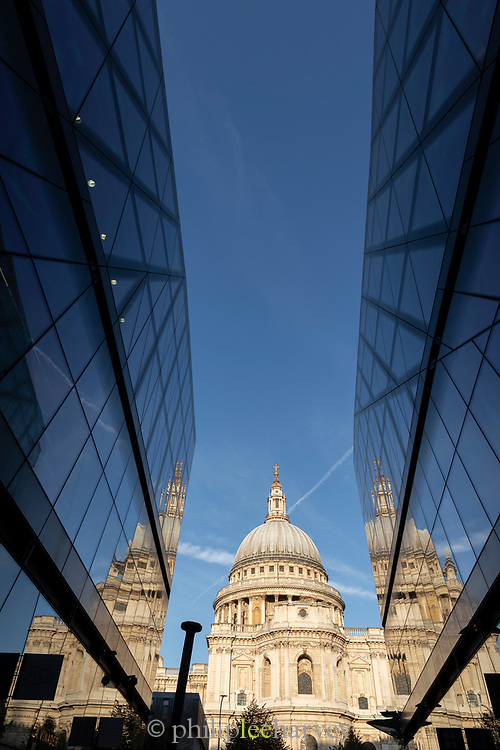 View of St. Paul's Cathedral between glass buildings, London, England, UK