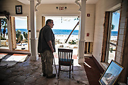 Thomas L Wood inside what is left of  his hotel, the Driftwood Inn in  Mexico Beach, Florida that was badly damaged by Hurricane Michael.