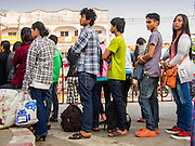 02 MARCH 2014 - MAE SOT, TAK, THAILAND:  Burmese citizens line up at Thai immigration offices in Mae Sot, Thailand, waiting to cross the Moie River so they can go back to Myanmar (Burma). The border crossing at Mae Sot and Myawaddy (on the Burma) side is the busiest border crossing on the Thai-Burma border.  PHOTO BY JACK KURTZ