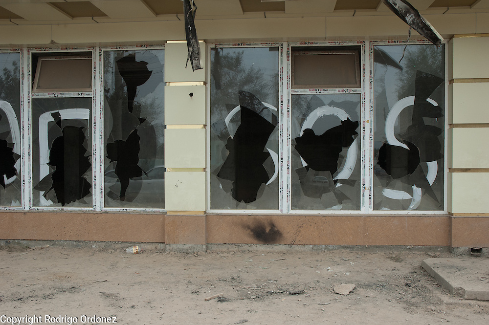 The acronym SOS is painted on the broken windows of a private hospital in the area of Kizil Kishtak (in Osh, Kyrgyzstan) that was destroyed during the violence that broke out in the city in June 2010.