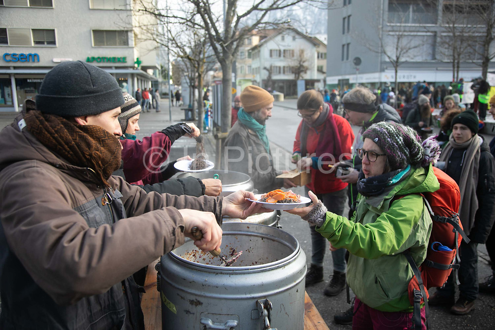 Food for the protesters on the first day of the Strike WEF march on Davos on 18th of January 2020 near Davos, Switzerland. The first day of the march started in Lanquart with speeches and hot food and ended in Schiers.  The protest is planned to finish in Davos with a public meeting in the town on the day the WEF begins. The march is a three day protest against the World Economic Forum meeting in Davos. The activists want climate justice and think that The WEF is for the worlds richest and political elite only.