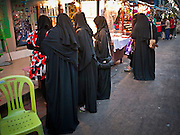 06 JULY 2011 - BANGKOK, THAILAND: Arab women shopping in the Soi Arab section of Bangkok. Soi Arab is an alleyway in Bangkok. What started as an alley has now grown into a neighborhood that encompasses several blocks of restaurants, hotels and money exchanges that cater to Middle Eastern visitors to Thailand. The official name of the street is Sukhumvit Soi 3/1, located in North Nana between Sukhumvit Soi 3 and Sukhumvit Soi 5, not far from the Nana Plaza night-life area and the Grace Hotel popular among Arabs.   PHOTO BY JACK KURTZ