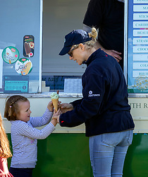 Zara Tindall with her daughter Mia at the Land Rover Gatcombe Horse Trials, on Gatcombe Park, Gloucestershire.