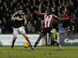 Bristol City's Derrick Williams challenges for the ball with  Brentford's Clayton Donaldson - Photo mandatory by-line: Dougie Allward/JMP - Tel: Mobile: 07966 386802 28/01/2014 - SPORT - FOOTBALL - Griffin Park - Brentford - Brentford v Bristol City - Sky Bet League One