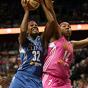 Rebekkah Brunson, (left), Minnesota Lynx, shoots over Kelsey Bone, Connecticut Sun, during the Connecticut Sun Vs Minnesota Lynx, WNBA regular season game at Mohegan Sun Arena, Uncasville, Connecticut, USA. 27th July 2014. Photo Tim Clayton