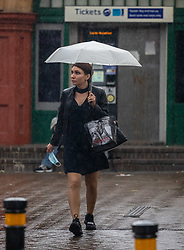 © Licensed to London News Pictures. 24/08/2020. London, UK. Commuters get caught in torrential rain in Putney in South West London as forecasters warn that Storm Francis is set to batter the UK later to night with winds in excess of 50mph along with more heavy rain. The Met Office has issued a yellow weather warning for high winds for most of the country which could lead to travel disruption and damage to trees. Photo credit: Alex Lentati/LNP