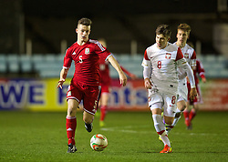 RHYL, WALES - Tuesday, March 18, 2014: Wales' Liam Angel in action against Poland during the Under-15's International Friendly match at Belle Vue. (Pic by David Rawcliffe/Propaganda)